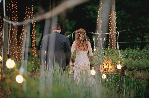 couple night rustic wedding lights outdoor