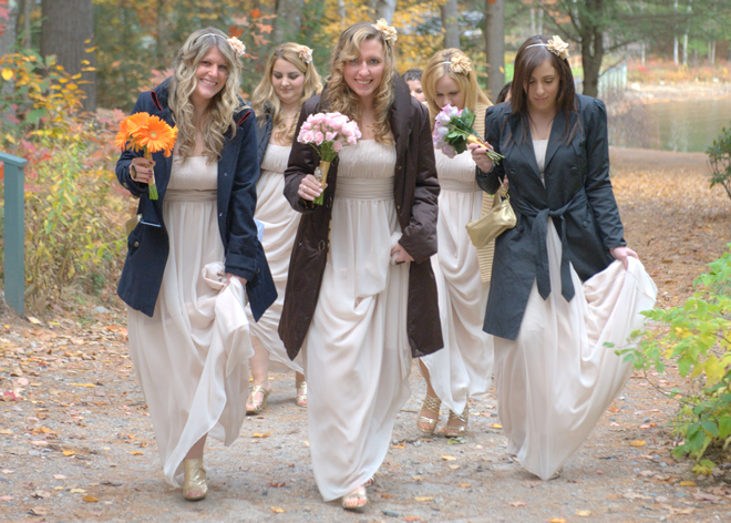 Lexi-and-Mike-wedding-migis-lodge-maine-fall-bridesmaids-walking-coats-_-glitterinc.com