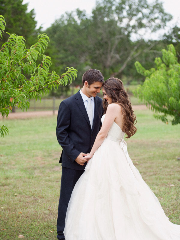 flowy layered tulle wedding dress couple