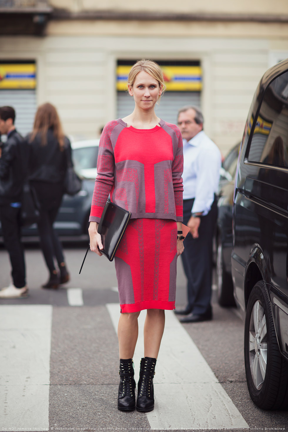 red sweater pin skirt street style