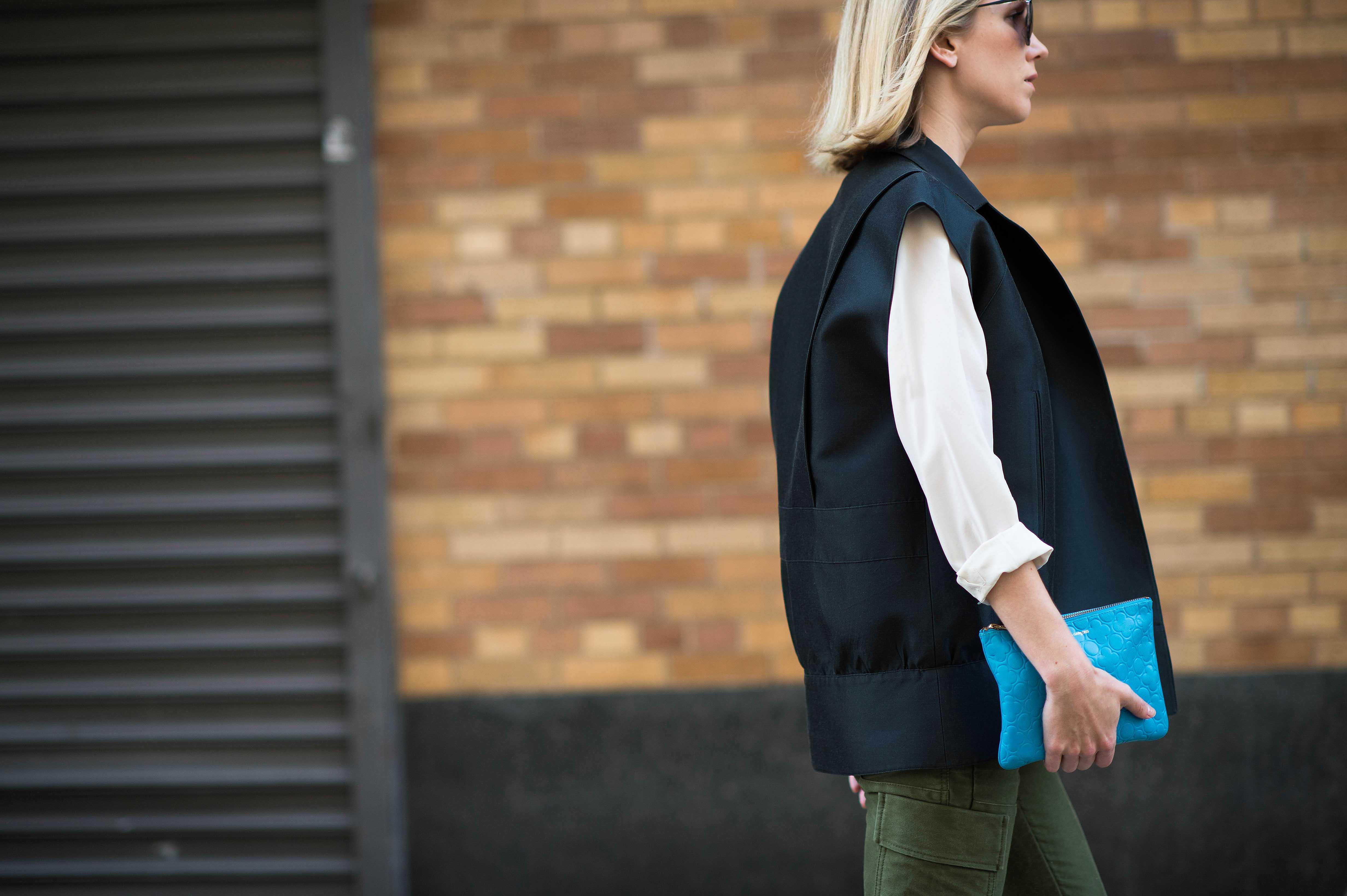 new-york-fashion-week-street-style-black vest green pants
