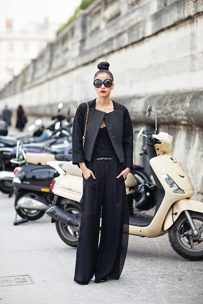 all black street style wide leg pants chic muse bun