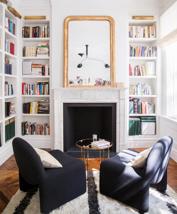 Ali Cayne NYC townhouse home Greenwich Village fire place books mirror