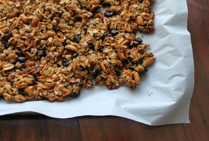 perfect-clumpy-granola-dried-fruit-nuts-parchment_-glitterinc.com