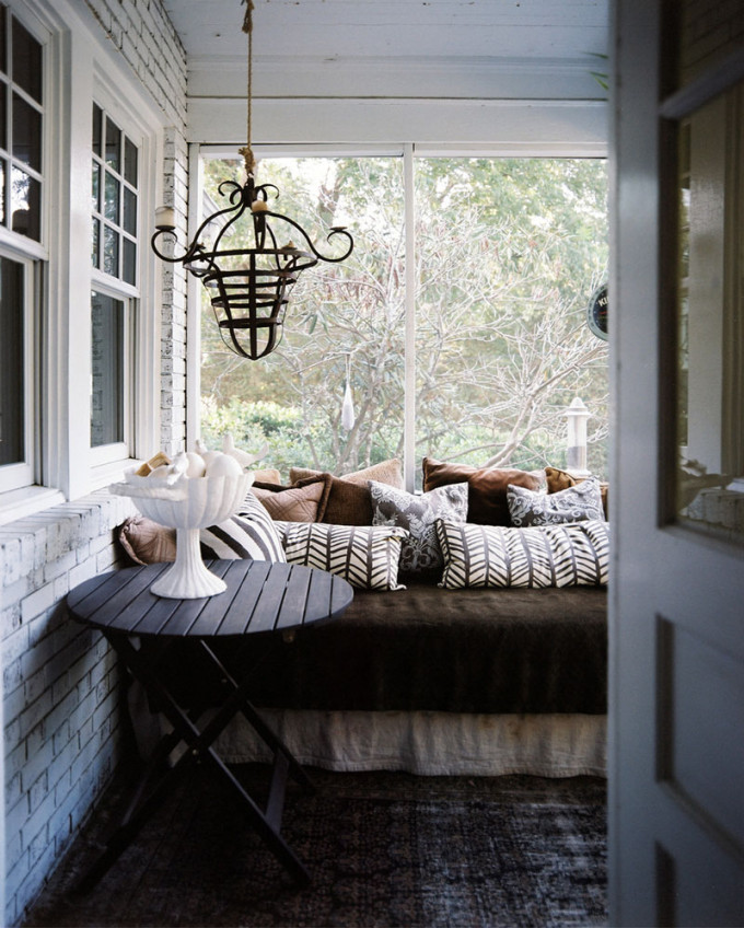 Porch+daybed+covered+patterned+pillows+iron