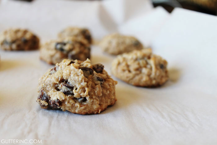 These thick and chewy oatmeal raisin cookies are everything I have ever wanted in an oatmeal raisin cookie - subtly sweet, oh-so-chewy with crispy buttery edges, and soft gooey oatmeal goodness at the center. You are going to love this recipe! | glitterinc.com | @glitterinc