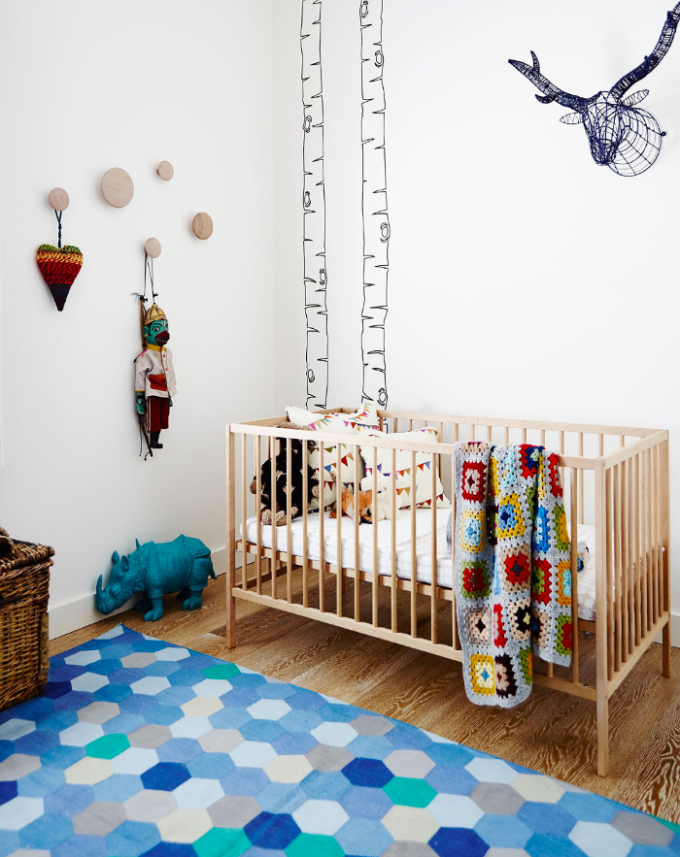 interiors - colorful bohemian nursery crib - lucy fenton - adore magazine