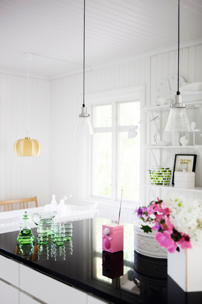 light bright Sweden home via Elle Decoration - kitchen flowers