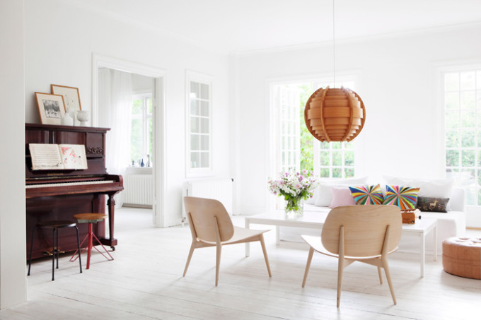light bright Sweden home via Elle Decoration - living room piano
