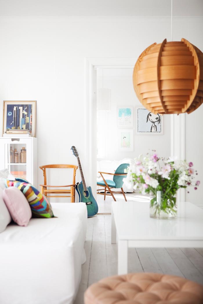 light bright Sweden home via Elle Decoration - white living room