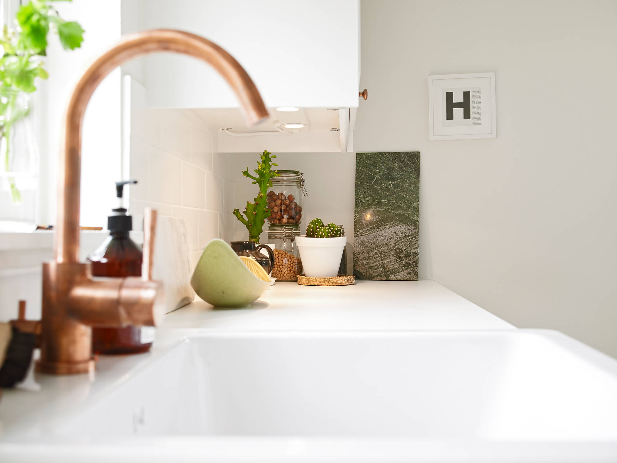 white apartment greens copper sink kitchen