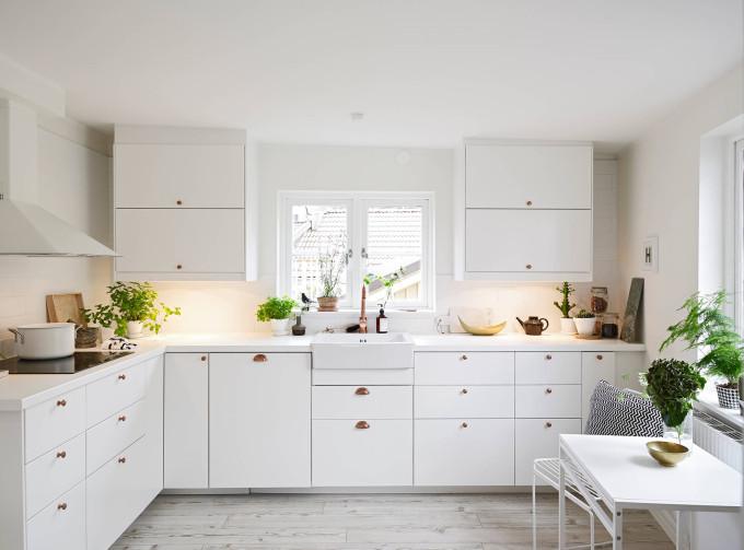 white apartment greens kitchen copper handles