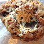 Toasted marshmallow-stuffed pumpkin muffins with streusel topping