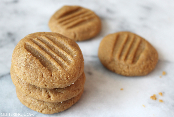Say hello to the very best peanut butter cookies around! Make and bake a batch in about ten minutes, and revel in the most delicious, flourless peanut butter cookies ever. Click through for the recipe. #peanutbuttercookies #cookies #peanutbuttercookiesrecipe #flourlesscookies #flourlesspeanutbuttercookies #threeingredientpeanutbuttercookies #easycookies | glitterinc.com | @glitterinc
