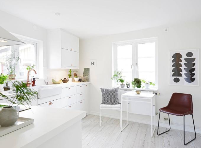 white apartment greens kitchen copper