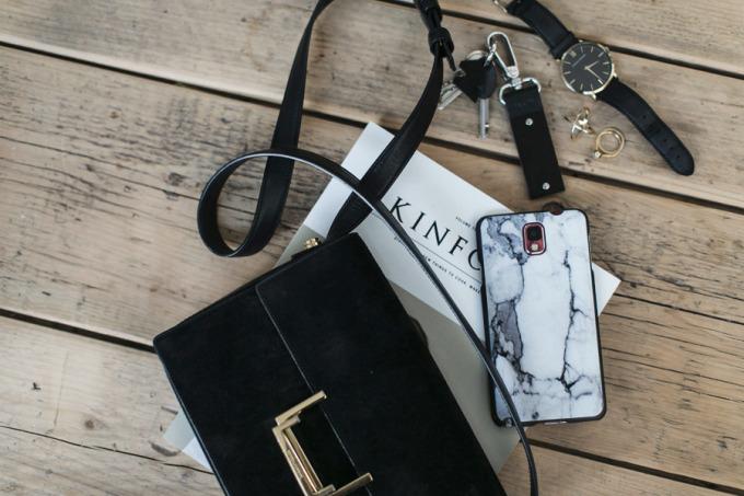 black purse - marble phone - kinfolk - wood