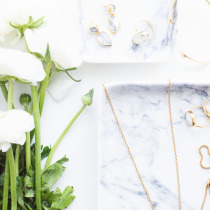 gold jewelry flowers marble
