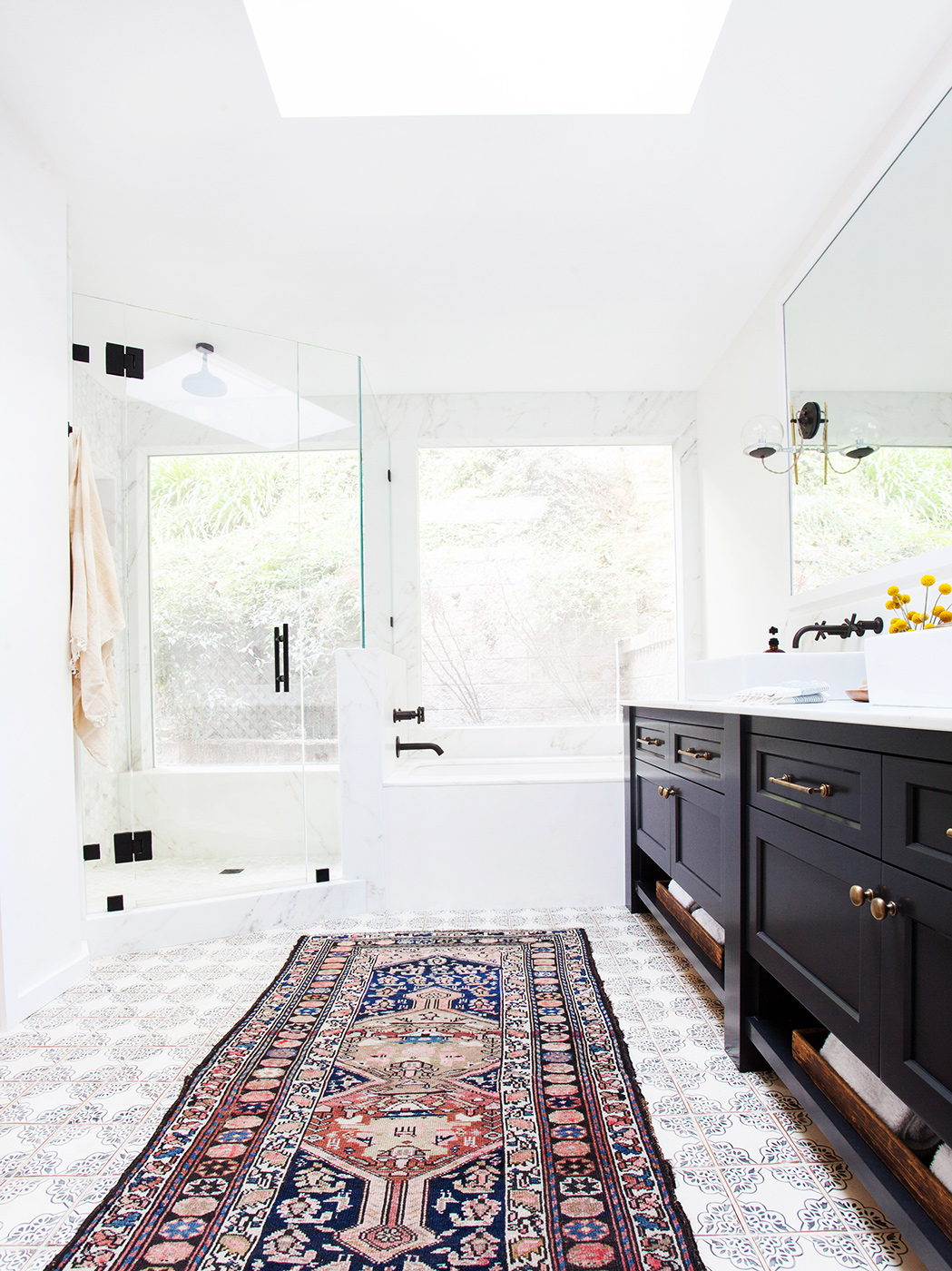 trend alert rugs in the bathroom mydomaine
