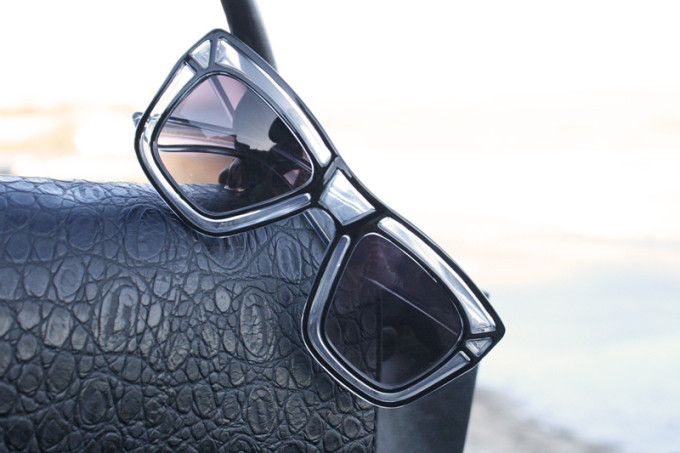 black outline sunglasses and celine bag