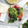 How to make caprese chicken sandwiches on crunchy ciabatta bread with balsamic greens and the best ever pesto mayo. Click through for the recipe.   glitterinc.com   @glitterinc