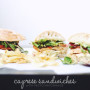 How to make caprese chicken sandwiches on crunchy ciabatta bread with balsamic greens and the best ever pesto mayo. Click through for the recipe. | glitterinc.com | @glitterinc