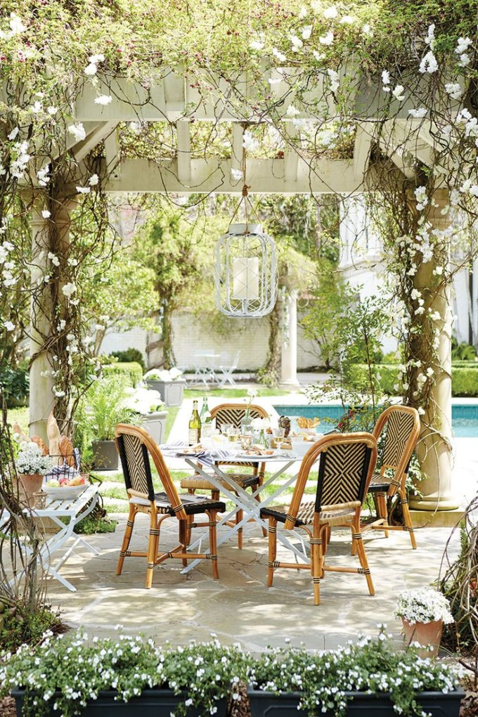 outdoor dining space table cafe chairs pergola trellis vines pool