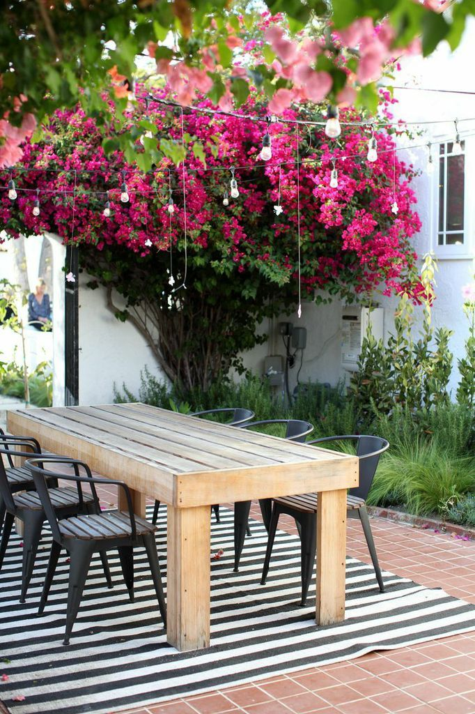 outdoor dining table cafe chairs flowers deck patio
