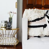 black white fringe pillows sofa living room gold side martini table
