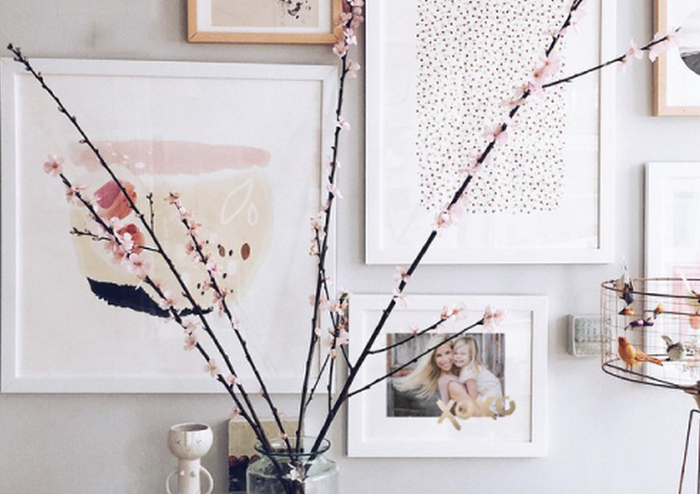 Unique Mother's Day Ideas, like creating a gallery wall of mom's favorite pictures for her.
