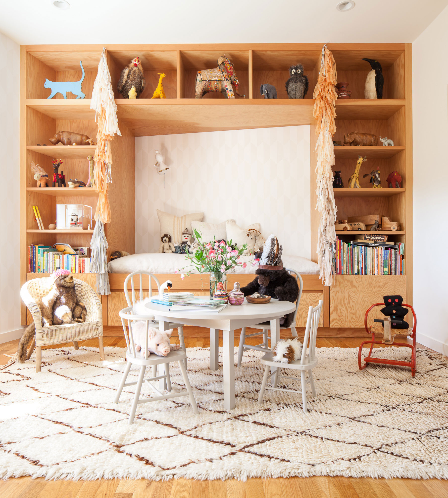 modern bohemian playroom nursery shelving