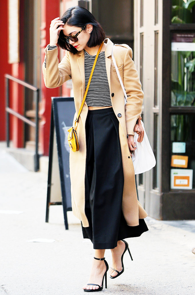 vanessa hudgens celebrity style guide - black stripe top camel coat