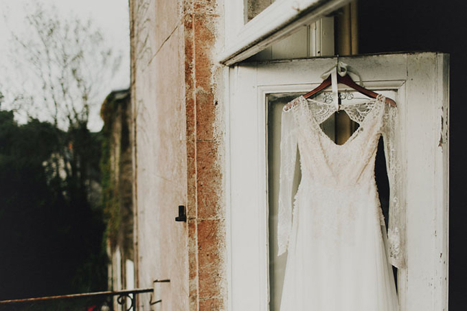 france-wedding-lace-sleeved-wedding-dress-hanging