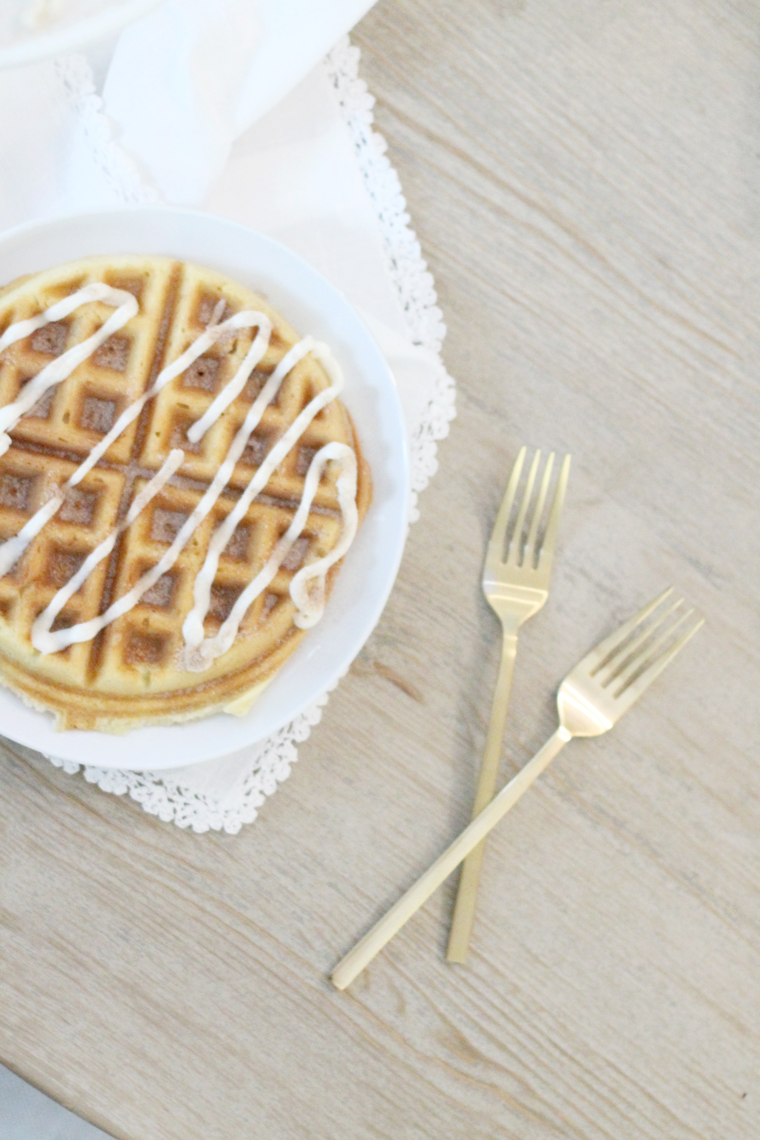 Cake-Mix-Cinnamon-Roll-Waffles-with-Vanilla-Frosting-Drizzle-and-Cinnamon-Sugar-topping---glitterinc.com