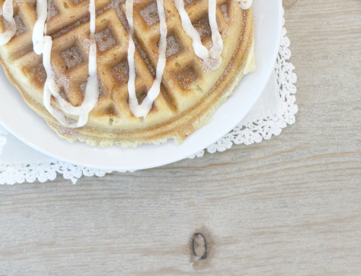 Cake-Mix-Cinnamon-Roll-Waffles-with-Vanilla-Frosting---close-up---glitterinc.com