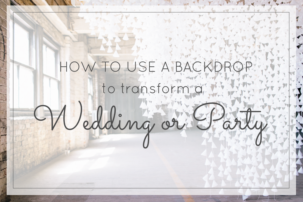 How to Use a Backdrop to Transform a Party or Wedding - DIY White Wax Paper Hanging Backdrop - glitterinc.com