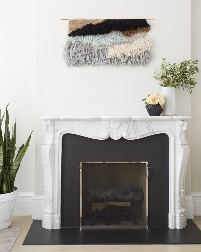 Jessi Randall of Loeffler Randall's Sleek White Park Slope, Brooklyn Renovation - Yarn Wall Hanging Design over the Fireplace