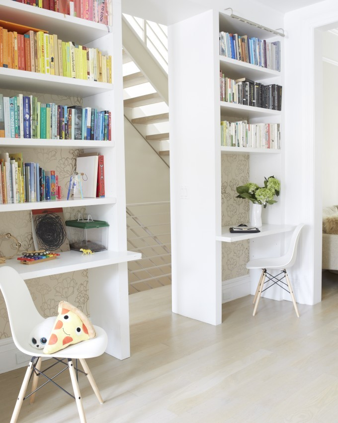 Jessi Randall of Loeffler Randall's Sleek White Park Slope, Brooklyn Renovation - Rainbow Color Organized Bookshelf Library Design