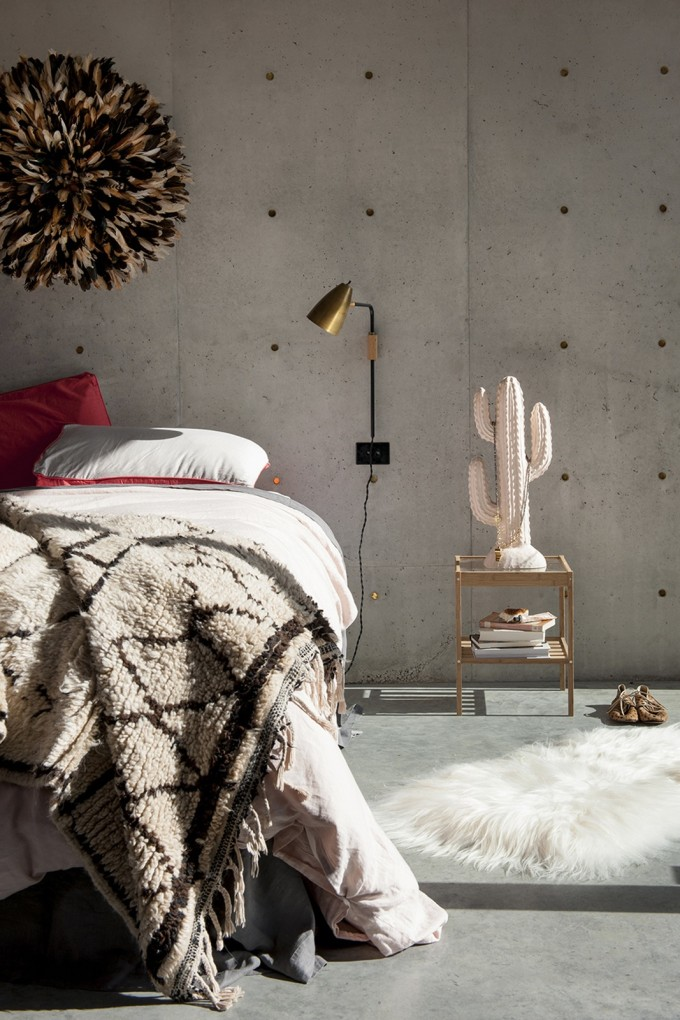 20 Ways to Decorate with African Juju Hats - Feather Headdresses - Interior Design - Bedroom with Juju Hat on the Wall