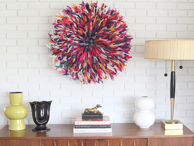 20 Ways to Decorate with African Juju Hats - Feather Headdresses - Interior Design - Colorful Juju Hat over an Entryway Table