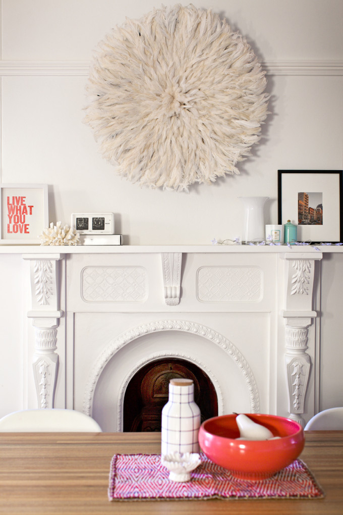 20 Ways to Decorate with African Juju Hats - Feather Headdresses - Interior Design - Juju Hat Over a Fireplace