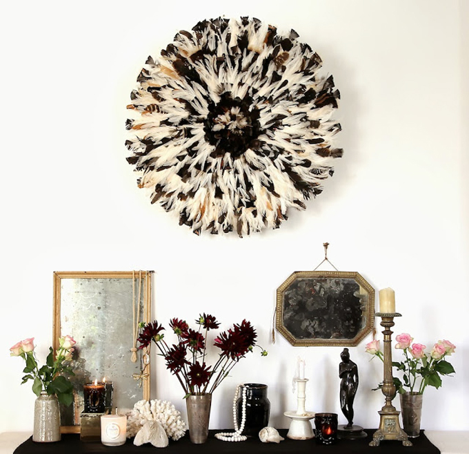 20 Ways to Decorate with African Juju Hats - Feather Headdresses - Interior Design - Black and White Juju Hat Display
