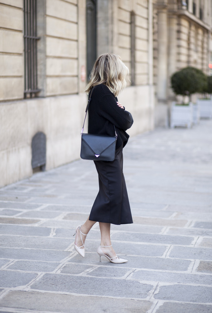 black sweater on black midi skirt