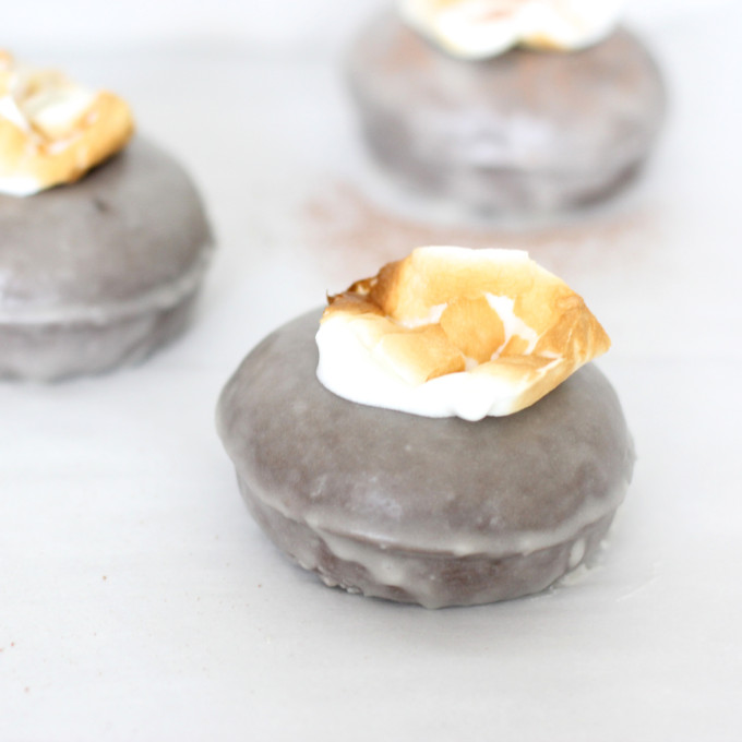 Hot chocolate donut recipe topped with toasted marshmallows - the perfect winter treat. (These are incredible! Just sayin'.) | glitterinc.com | @glitterinc