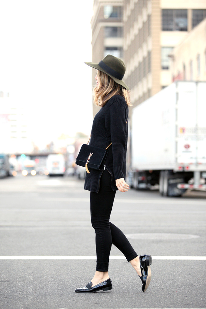 Throwback Vibe All Black Street Style Outfit with a hat, YSL bag, and Black Patent Loafers