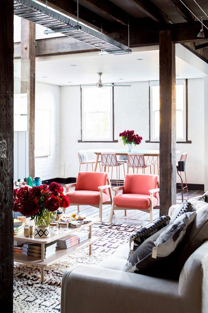 How to Add Pink to Your Home And Still Keep Your Guy Happy: Coral Chairs Are Soothing Against Dove Grey and Wood in this Living Room