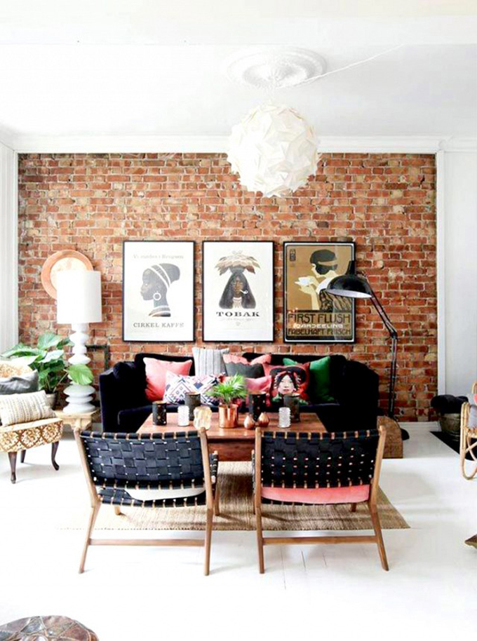 How to Add Pink to Your Home And Still Keep Your Guy Happy: Pink Pillows Pop Against Black Chairs and Sofa Plus a Brick Wall - Living Room