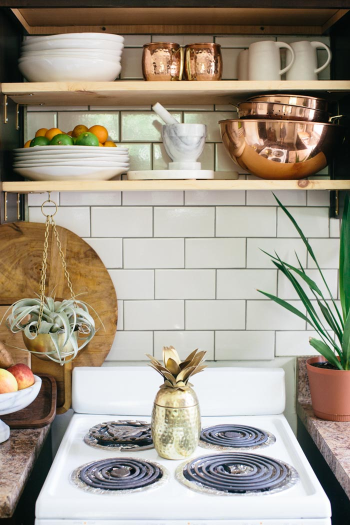How to Style Copper in the Kitchen: Copper Details in a Kitchen (love the gold pineapple!)