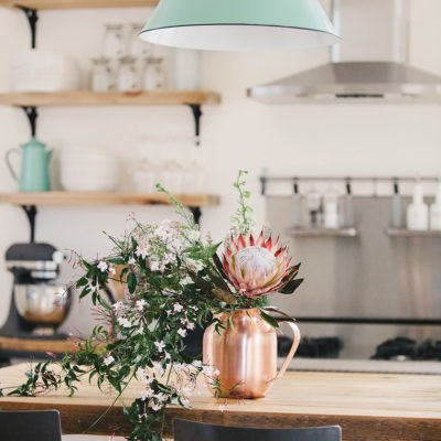 Copper Pitcher of Flowers in the Kitchen