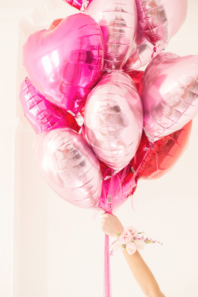 12 Inexpensive Valentine's Day Date Night Ideas (From the Comfort of Your Sofa): Fill Your Living Room with Heaps of Balloons