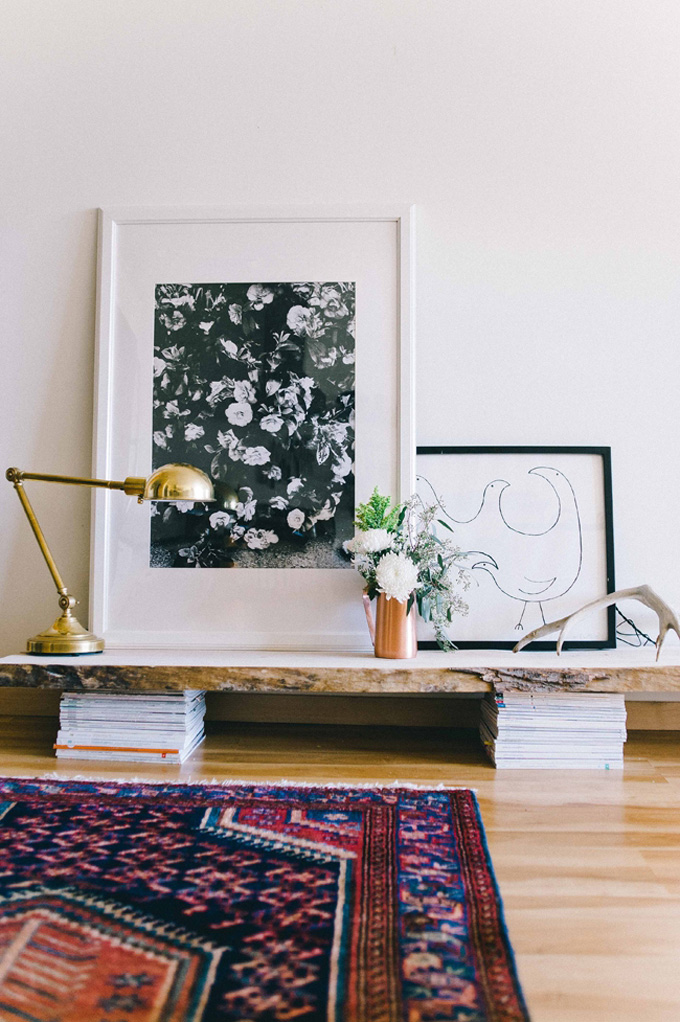 Leaning Black and White Flower Wall Art on a Low Shelf